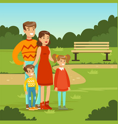 Happy young family spending time in city park vector
