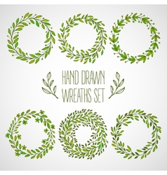 Set of hands drawn decorative wreaths vector