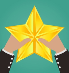 Businessman hands catching gold star vector