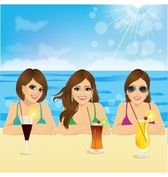 Three young women on the beach vector