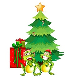 Christmas theme with two frogs and christmas tree vector