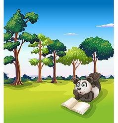 A panda lying at the grass while reading a book vector