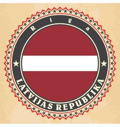 Vintage label cards of latvia flag vector