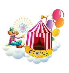 A clown beside a circus tent with balloons vector image
