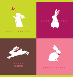 Four white bunny silhouettes vector