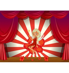 A stage with a fairy in a red dress vector image