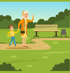 Happy grandmother spending time with kid in park vector