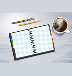 Notebooke and cup of hot coffee vector