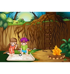 Children looking at map in the jungle vector image vector image
