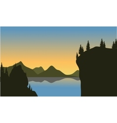 Silhouette of cliff on the lake vector