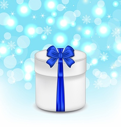 Gift box with blue bow on glowing background vector