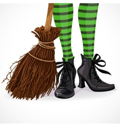 Halloween witch legs in boots and with broomstick vector