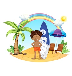 A boy and his surfing board at the beach vector image
