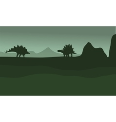 Stegosaurus in fields scenery silhouette vector