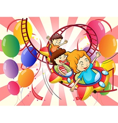 Kids enjoying the roller coaster ride vector image vector image