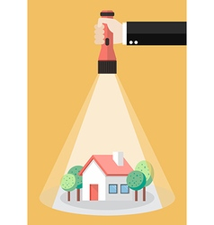 Hand holding flashlight glow to the house property vector