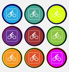 Cyclist icon sign Nine multi colored round buttons vector image