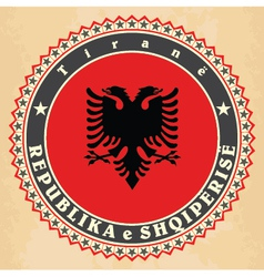 Vintage label cards of Albania flag vector image vector image