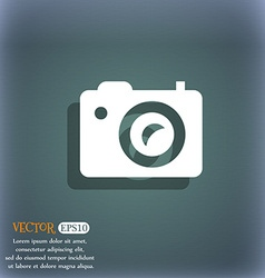 Digital photo camera icon symbol on the blue-green vector