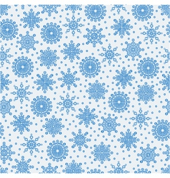 Seamless pattern with lots of snowflakes on a whit vector