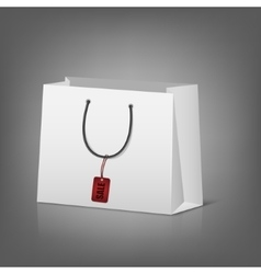 Blank paper shopping bags with sale tag vector