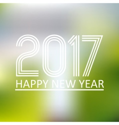 Happy new year 2017 on blur abstract background vector