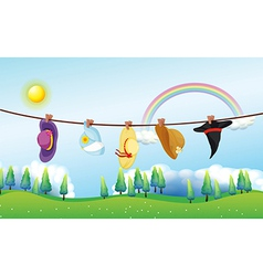 Different kinds of hats hanging under the sun vector