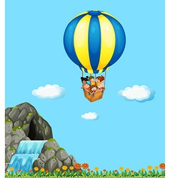Children riding on balloon in the sky vector image vector image