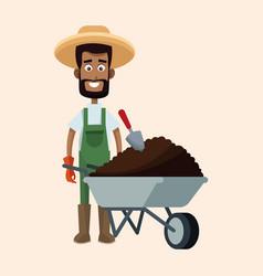 African farmer man straw hat wheelbarrow earth vector