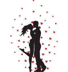 Kissing couple and hearts vector