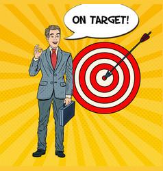 Pop art happy businessman achieved the target vector