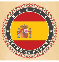 Vintage label cards of spain flag vector