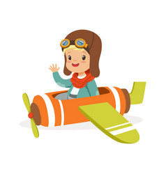 Cute little boy in pilot costume flying toy plane vector