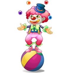 A clown juggling above the ball vector