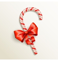 candy cane with red bow vector image vector image