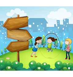 Three kids playing in the garden with wooden vector image