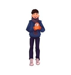 Handsome young man making a snowball vector image