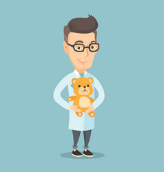 Pediatrician doctor holding teddy bear vector
