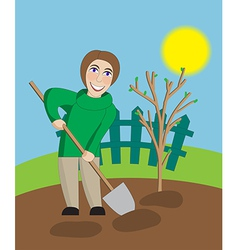 Middle aged woman digs in the spring garden vector