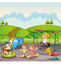 Children playing in the playground at daytime vector