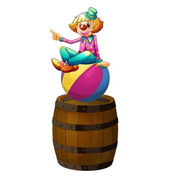 A ball with a clown above the wooden barrel vector image