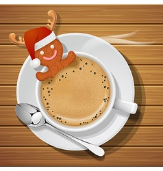 Gingerbread man with santa claus hat in coffee cup vector