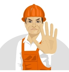 Road worker in hard hat showing stop gesture vector