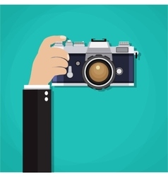 Flat of photo camera with hand vector