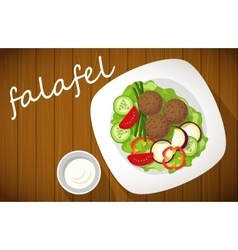 Plate of falafel on wooden table top view vector