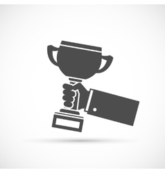 Holding trophy cup in hand vector image vector image