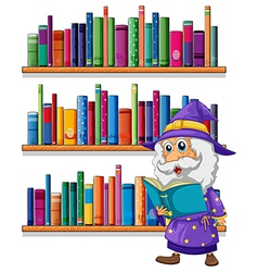 A wizard reading a book in front of the vector image vector image