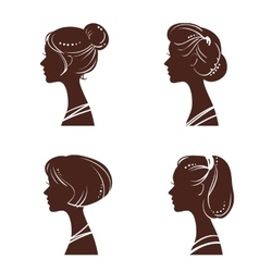 Four silhouettes of women vector