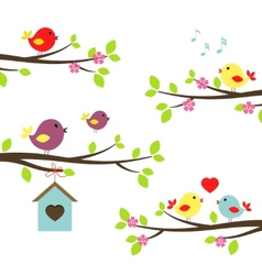 Set of birds on flowering branches vector