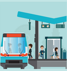 People wait for a train at train station platform vector